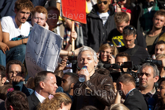 Julian Assange.<br /> <br /> London, 15/10/2011. St Paul's Square became the stage of the UK arm of the &quot;Occupy&quot; protest movement which has been growing around the world. The Occupy movement is a world-wide protest against the financial crises created by the actual financial system, by speculation, by deregulation, and by the actions of major international financial and investment banks. Around 2,000 protesters armed with tents and placards, gathered outside the famous Cathedral intending to occupy Paternoster Square, home of the London Stock Exchange and the heart of the City of London, but they were hampered by City police officers. After this failed attempt the protesters decided to camp in front St Paul's where the situation with police forces became immediately tense. Masked like the character of Guy Fawkes from the movie &quot;V for Vendetta&quot;, Julian Assange appeared on the square to give a speech in support of the protesters. During the late evening police forces heavily armed with riot control equipment charged the square, attempting to evict the occupants who resisted. Later in the evening the police retreated and the occupation continued peacefully.