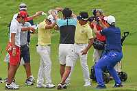 Fans and Players douse new champion, Takumi KANAYA (JPN) with water after winning the Asia-Pacific Amateur Championship, Sentosa Golf Club, Singapore. 10/7/2018.<br /> Picture: Golffile | Ken Murray<br /> <br /> <br /> All photo usage must carry mandatory copyright credit (&copy; Golffile | Ken Murray)