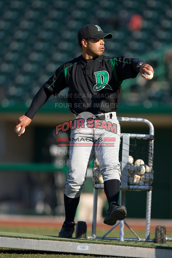 Dayton Dragons hitting coach Tony Jaramillo #16 throws batting practice at Parkview Field April 16, 2009 in Fort Wayne, Indiana. (Photo by Brian Westerholt / Four Seam Images)