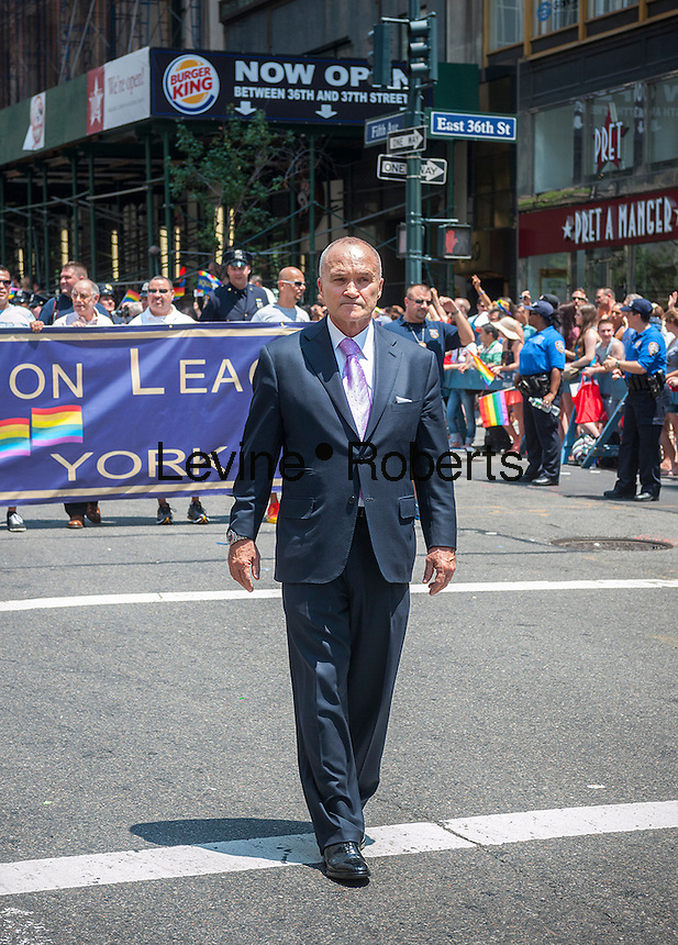 NYPD Commissioner Raymond Kelly with the members of the Gay Officers Action League (GOAL) in the 44th annual Lesbian, Gay, Bisexual and Transgender Pride Parade on Fifth Avenue in New York on Sunday, June 30, 2013. The turn out for the parade was especially large with the recent Supreme Court decision overturning the Defense of Marriage Act (DOMA) and California's Proposition 8.  (© Richard B. Levine)