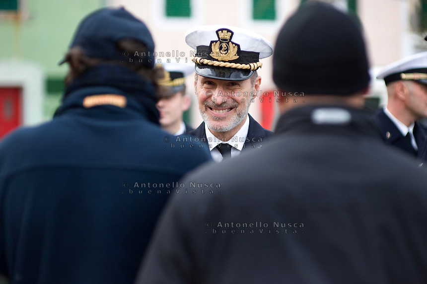 Il Capitano della Guardia Costiera Gregorio De Falco al Porto dell'Isola del Giglio durante le commemorazioni per il primo anniversario del disastro della nave da Crociera Costa Concordia..Italian Captain Gregorio De Falco stands in the port of the Italian island of Giglio on January 13, 2013 during commemorations marking the first anniversary of the Costa Concordia cruise ship disaster. Survivors, grieving relatives and locals on the island of Giglio gathered on January 13 to mark the first anniversary of the Costa Concordia cruise ship disaster, which claimed 32 victims.