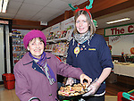 Kathleen travers samples some christmas cake from Brenda Rice at the open day at Centra Ardee. Photo: Colin Bell/pressphotos.ie