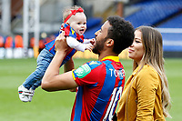 Andros Townsend of Crystal Palace plays with his daughter during the EPL - Premier League match between Crystal Palace and West Bromwich Albion at Selhurst Park, London, England on 13 May 2018. Photo by Carlton Myrie / PRiME Media Images.