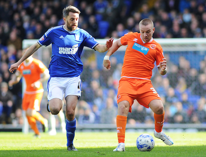 Blackpool's Jamie O'Hara under pressure from Ipswich Town's Cole Skuse<br /> <br /> Photographer Kevin Barnes/CameraSport<br /> <br /> Football - The Football League Sky Bet Championship - Ipswich Town v  Blackpool - Saturday 11th April 2015 - Portman Road - Ipswich<br /> <br /> &copy; CameraSport - 43 Linden Ave. Countesthorpe. Leicester. England. LE8 5PG - Tel: +44 (0) 116 277 4147 - admin@camerasport.com - www.camerasport.com