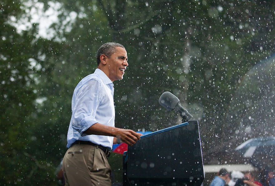 U.S. President Barack Obama speaks in the rain during a campaign rally in Glen Allen, Virginia.