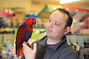 Date 15/03/2019 - SPECIAL TO GO WITH OWEN BOWCOTT STORY - Border Brexit- Strabane pet store owner Andrew Montgomery with his Peppa the Parrot. Photo/Paul McErlane