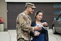 Happy young off duty Us army family with baby, Stock Photo