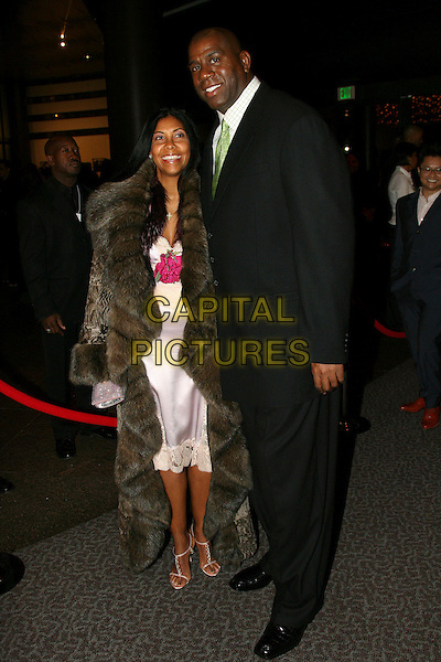 MAGIC JOHNSON & COOKIE (WIFE).16th Annual NAACP Theatre Awards - Arrivals held at the Director's Guild of America, Los Angeles, California, USA..February 20th, 2006.Photo: Zach Lipp/AdMedia/Capital Pictures.Ref: ZL/ADM.full length black suit brown fur coat married husband.www.capitalpictures.com.sales@capitalpictures.com.© Capital Pictures.