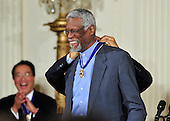 """United States President Barack Obama and first lady Michelle Obama present the 2010 Medal of Freedom, """"the Nation's highest civilian honor presented to individuals who have made especially meritorious contributions to the security or national interests of the United States, to world peace, or to cultural or other significant public or private endeavors"""", to basketball legend Bill Russell in a ceremony in the East Room of the White House in Washington, D.C. on Tuesday, February 15, 2011. .Credit: Ron Sachs / CNP"""