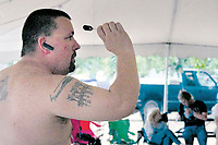 MEGAN DAVIS/MCDONALD COUNTY PRESS The love of darts runs deep – skin deep for some. Dart enthusiasts are set to gather at Wayside Campground June 6 -9 to partake in the 38th Annual Chicken Coop Open.