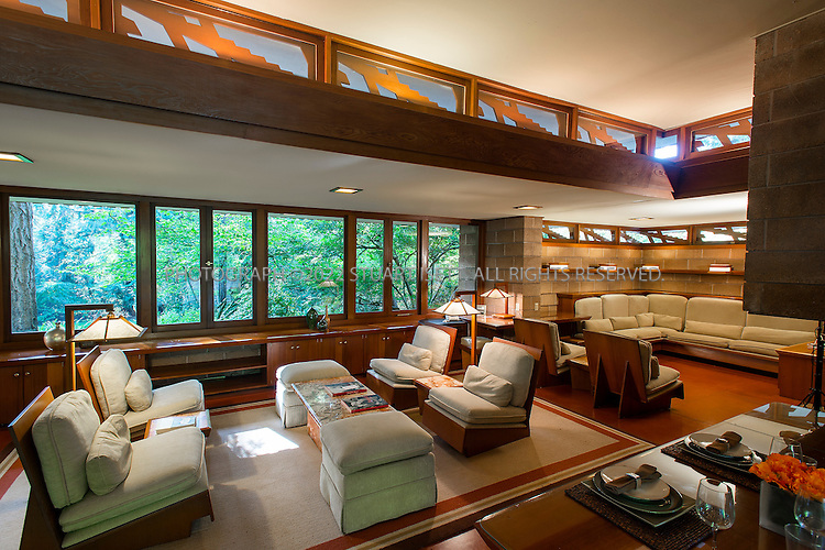 "10/9/2012--Sammamish, WA, USA..VIEW: Living room...Architect Frank Lloyd Wright planned his ""Usonian"" homes to be affordable for middle-class families. The 1,9500 square foot Brandes home is for sale in Sammamish, Washington (30 minutes from Seattle) at $1.39 million. It features three bedrooms, two bathrooms and a small, separate office/study space...The home was built in 1952, and has redwood trim and Wright's original furniture and some garden sculptures by Wright. It's one of only three Frank Lloyd Wright homes near Seattle...©2012 Stuart Isett. All rights reserved."