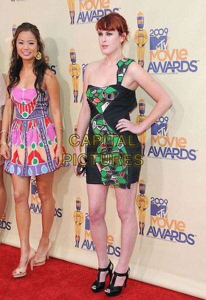 JAMIE CHUNG & RUMER WILLIS.The 2009 MTV Movie Awards held at Universal Ampitheatre  in Universal City, California, USA..May 31st, 2009  .full length dress hand on hip black green one shoulder patches peep toe t-bar shoes sandals blue purple yellow green pattern print jaime pink strapless .CAP/DVS.©Debbie VanStory/Capital Pictures.