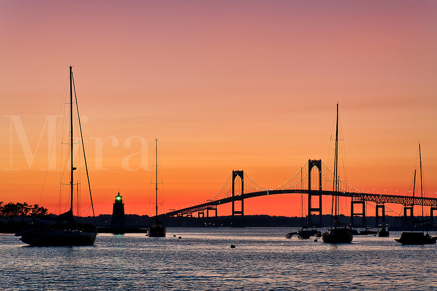 Goat Island lighthouse and the Jamestown or Pell Bridge at sunset, Newport, RI, Rhode Island