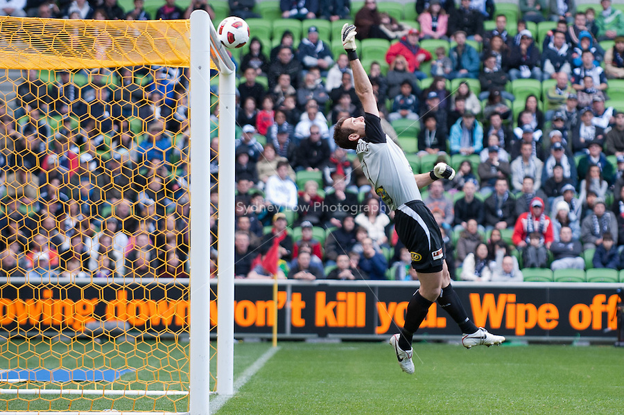 MELBOURNE, AUSTRALIA - SEPTEMBER 12, 2010: Michael Theoklitos from the Roar flicks the ball over the bar in Round 6 of the 2010 A-League between the Melbourne Victory and Brisbane Roar at AAMI Park on September 12, 2010 in Melbourne, Australia. (Photo by Sydney Low / Asterisk Images)