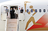 20th March 2020, Miyagi, Tohoku Region, Japan, Olympic gold medalists Tadahiro Nomura and Saori Yoshida exit the plane with the Olympic flame prior to the Olympic flame arrival ceremony in Miyagi of Japan, on March 20, 2020.