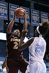 21 November 2015: Iona's Aurellia Cammock (2) grabs a rebound over North Carolina's Destinee Walker (24). The University of North Carolina Tar Heels hosted the Iona College Gaels at Carmichael Arena in Chapel Hill, North Carolina in a 2015-16 NCAA Division I Women's Basketball game. UNC won the game 64-52.