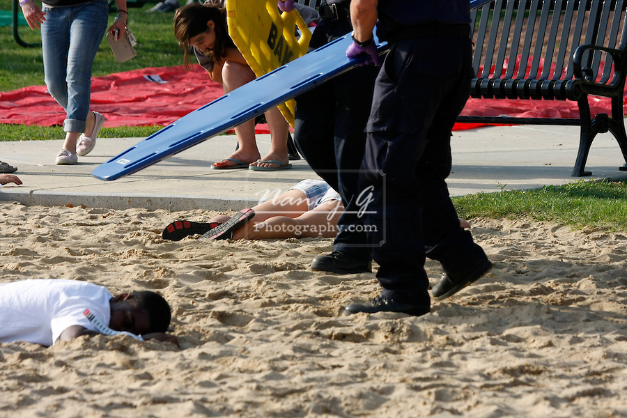 An EMT at a scene of a mass casulty incident helping on one of the victims
