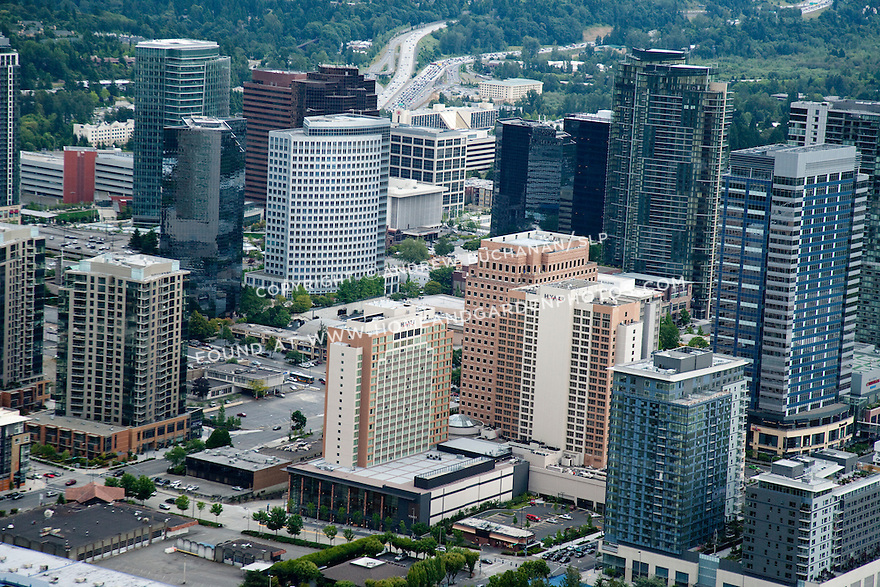 An aerial cityscape view of downtown Bellevue, WA skyscrapers.