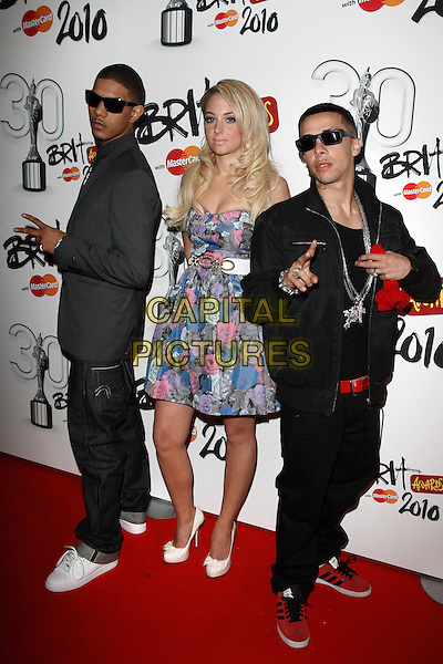 """N-DUBZ - Richard Rawson, Tula Contostavlos & Dino """"Dappy"""" Contostavlos .Brit Awards Nominations at Indigo O2, London, England, UK,.January 18th 2010..brits N Dubz full length strapless blue pink floral print dress white shoes sunglasses red black jeans trainers waist belt necklaces bling band group .CAP/ROS.©Steve Ross/Capital Pictures"""