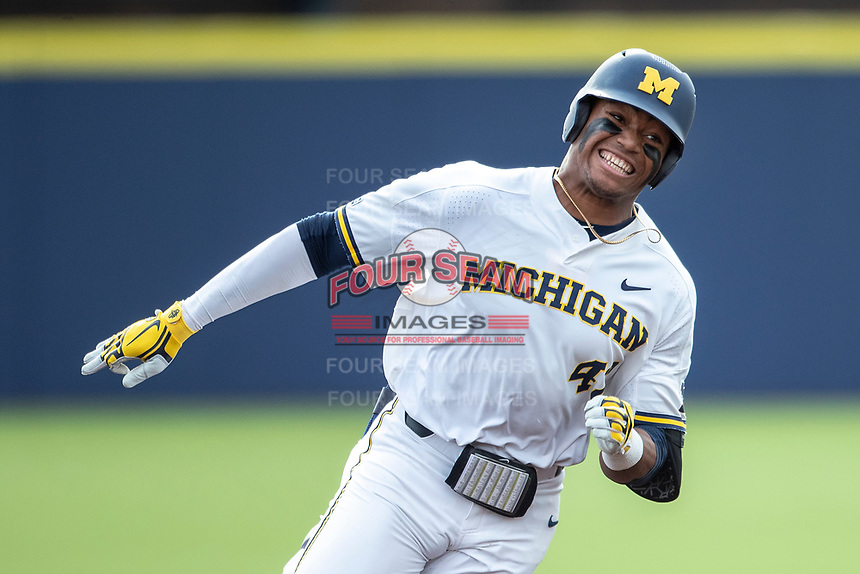 Michigan Wolverines designated hitter Jordan Nwogu (42) heads to third base after leading off the NCAA baseball game with a triple against the Michigan State Spartans on May 7, 2019 at Ray Fisher Stadium in Ann Arbor, Michigan. Michigan defeated Michigan State 7-0. (Andrew Woolley/Four Seam Images)