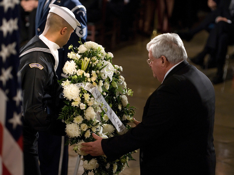 Speaker of the House Dennis Hastert lays a wreath during the state funeral for former President Gerald Ford in the Rotunda of the U.S. Capitol in Washington on Saturday evening, Dec. 30, 2006.