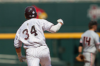 Mississippi State outfielder Hunter Renfroe (34) pumps his fist as he rounds the bases after hitting a three run home run in the fifth inning of Game 11 at the 2013 Men's College World Series against the Oregon State Beavers on June 21, 2013 at TD Ameritrade Park in Omaha, Nebraska. The Bulldogs defeated the Beavers 4-1, to reach the CWS Final and eliminating Oregon State from the tournament. (Andrew Woolley/Four Seam Images)
