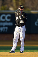 Wake Forest Demon Deacons shortstop Jimmy Redovian (23) signals what pitch is coming to his second baseman during the game against the Georgetown Hoyas at Wake Forest Baseball Park on February 16, 2014 in Winston-Salem, North Carolina.  The Demon Deacons defeated the Hoyas 3-2.  (Brian Westerholt/Four Seam Images)
