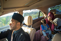 January 15, 2015 - Rawang (Malaysia). Mardiona Hakim, wife no 4 of Global Ikhwan's CEO, Lokman Hakim (driving the car) with two of their children. Mardiona was born in Australia from a Malaysian family and she married Lokman in 2005. She now works at the company's laundry. © Thomas Cristofoletti / Ruom
