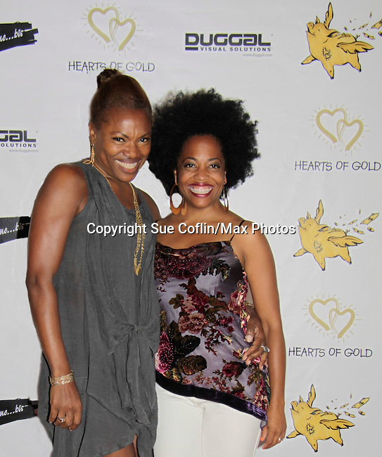 Founder Deborah Koenigsberger poses with Another World Rhonda Ross sings at Hearts of Gold - 45 A Different Kind of Fund Raiser on July 10, 2014 at Manhattan Penthouse, New York City, New Yor (Photo by Sue Coflin/Max Photos)