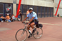 Bike police officer age 34 patrolling the Marilyn Manson rock concert.  Minneapolis Minnesota USA