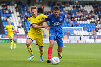 Ryan Tafazolli of Peterborough United (right) under pressure by James Henry of Oxford United during the Sky Bet League 1 match between Peterborough and Oxford United at the ABAX Stadium, London Road, Peterborough, England on 30 September 2017. Photo by David Horn.