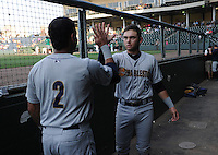 Infielder Dante Bichette Jr. (19) of the Charleston RiverDogs, right, high-fives infielder Cito Culver (2) in the dugout just before a game against the Greenville Drive on May 31, 2012, at Fluor Field at the West End in Greenville, South Carolina. Charleston won, 13-2.  (Tom Priddy/Four Seam Images)