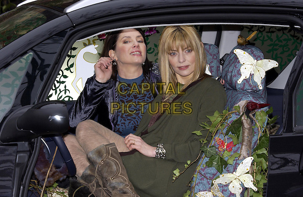 SADIE FROST & JEMIMA FRENCH.Revealing Their Designs for New Innovation Peugeot 1007..St Mary Magdelaine Church, Rowington Close, W2..February 16th, 2005.half length green jacket coat tight stockings boots car sitting butterflies touching ear gesture.www.capitalpictures.com.sales@capitalpictures.com.©Capital Pictures