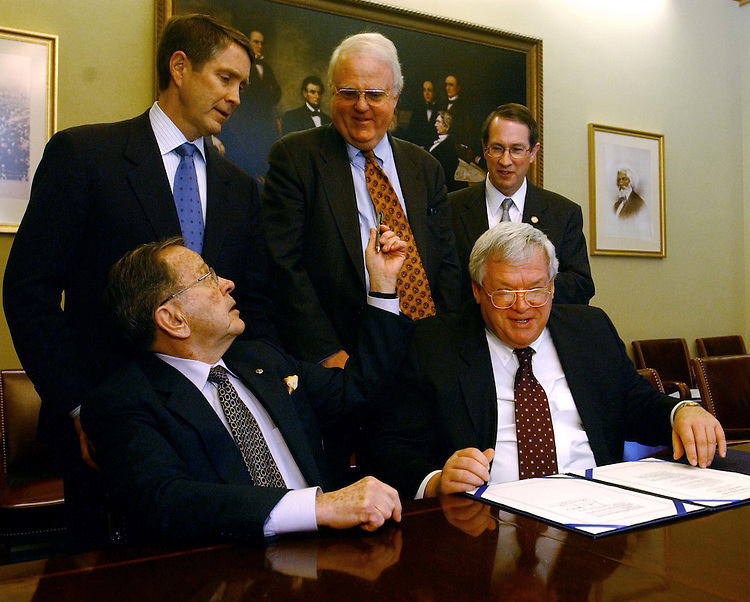 "01/17/05.CLASS ACTION BILL--After the House cleared the legislation designed to shift many class action suits from state to federal courts, Senate Majority Leader Bill Frist, R-Tenn., left, Rep. F. James Sensenbrenner Jr. R-Wis., and Rep. Robert W. Goodlatte, R-Va., and (seated) Senate President Pro Tempore Ted Stevens, R-Alaska, and House Speaker J. Dennis Hastert, R-Ill., talk to reporters after signing the bill to make it ready for President Bush's signature..From CQ Today: ""Final passage of the bill (S 5) by 279-149 marked the biggest victory in years for President Bush and business community advocates of overhauling the civil justice system. The Senate passed the measure Feb. 10 by a vote of 72-26..Before voting on the bill, the House rejected by 175-249 a motion to recommit by Sherrod Brown, D-Ohio, that have would exempted class action cases involving the drug Vioxx, a pain relief medication withdrawn from the market because of heart attack risks..The House rejected by 178-247 a Democratic substitute offered by Judiciary Committee ranking Democrat John Conyers of Michigan that incorporated amendments rejected in the Senate last week."".CONGRESSIONAL QUARTERLY PHOTO BY SCOTT J. FERRELL"