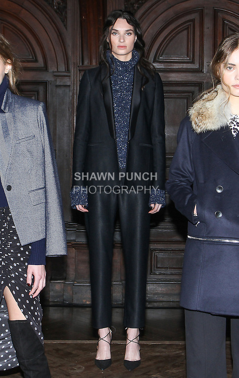 "Model Morganne poses in an indigo tweed yan flare sleeve turtleneck, black stretch satin twill soft tailored tux jacket and black stretch satin twill tapered trouser, from the Veronica Beard Fall 2016 ""Gypsy Caravan"" collection presentation, at the Highline Hotel on February 15 2016, during New York Fashion Week Fall 2016."