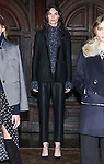 """Model Morganne poses in an indigo tweed yan flare sleeve turtleneck, black stretch satin twill soft tailored tux jacket and black stretch satin twill tapered trouser, from the Veronica Beard Fall 2016 """"Gypsy Caravan"""" collection presentation, at the Highline Hotel on February 15 2016, during New York Fashion Week Fall 2016."""