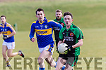 Cathal Rogers, Churchill races forward with the ball well in his grip with  Bill Cronin of Cordal giving chase when the sides clashed at Churchill's new ground last Sunday afternoon.