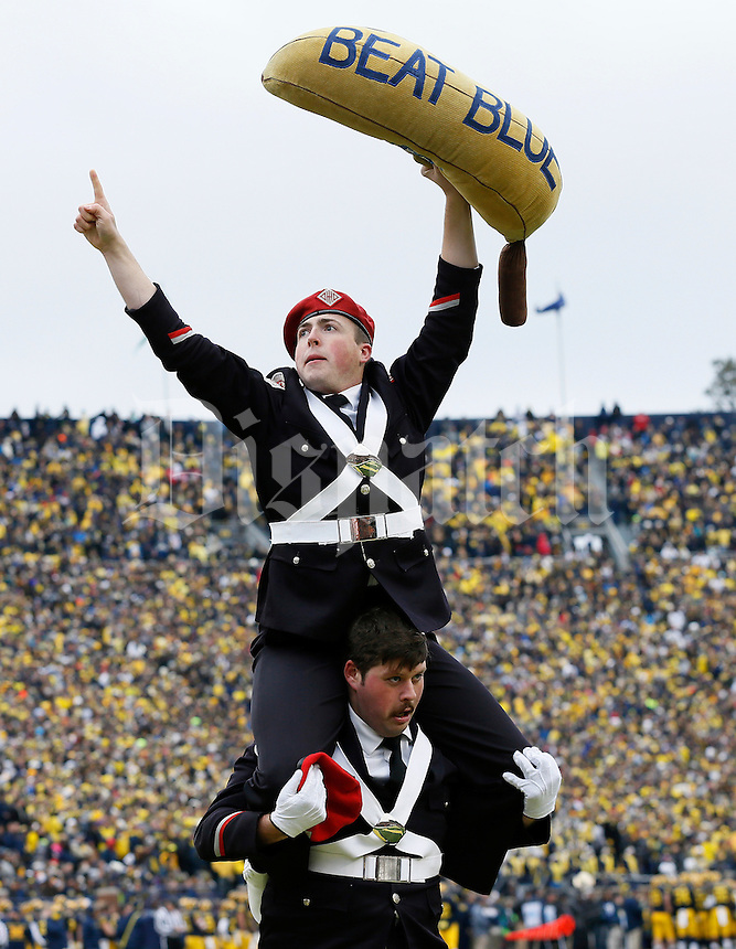 Members of the Ohio State Marching Band run on the field following a touchdown during the fourth quarter of the NCAA football game against the Michigan Wolverines at Michigan Stadium in Ann Arbor on Nov. 28, 2015. Ohio State won 42-13. (Adam Cairns / The Columbus Dispatch)