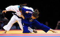 04 DEC 2011 - LONDON, GBR - Maria Portela (BRA) (in white, on left) battles with Karine Berger (FRA) (in blue, on right) during the London International Judo Invitational and 2012 Olympic Games test event at the ExCel Exhibition Centre in London, Great Britain .(PHOTO (C) NIGEL FARROW)