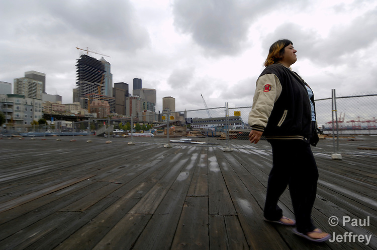 Jessie Pedro, a once homeless woman in Seattle, walks the city streets.