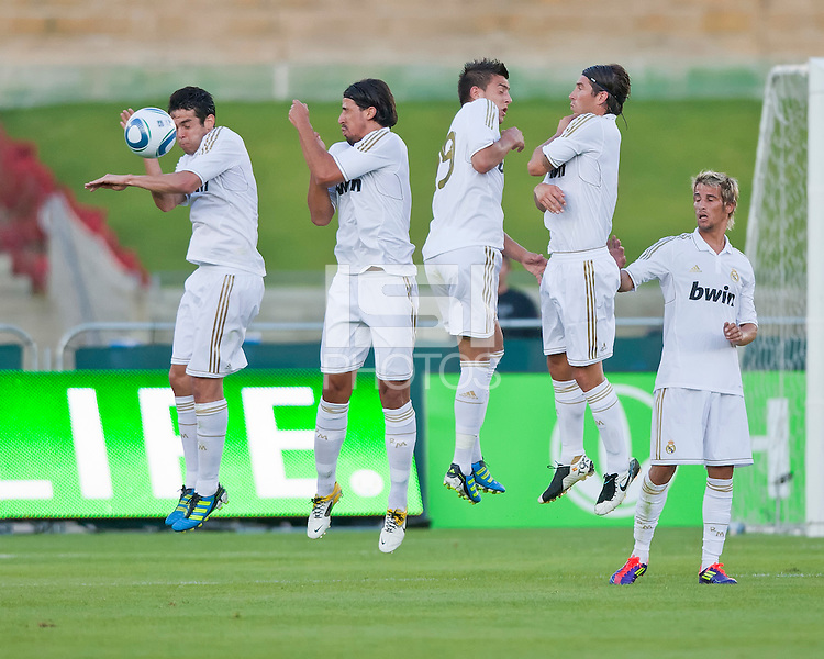 LOS ANGELES, CA – July 16, 2011: Kaka' (8), blocks a penalty kick while teammates Sami Khedira (6), Joselu (29), Sergio Ramos (4) and Fabio Coentrao (15) of Real Madrid form the wall during the match between LA Galaxy and Real Madrid at the Los Angeles Memorial Coliseum in Los Angeles, California. Final score Real Madrid 4, LA Galaxy 1.