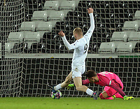 Pictured: Oli McBurnie of Swansea scores against Nils Koerber of Hertha Berlin Tuesday 28 February 2017<br /> Re: Premier League International Cup, Swansea City U23 v Hertha Berlin II at at the Liberty Stadium, Swansea, UK