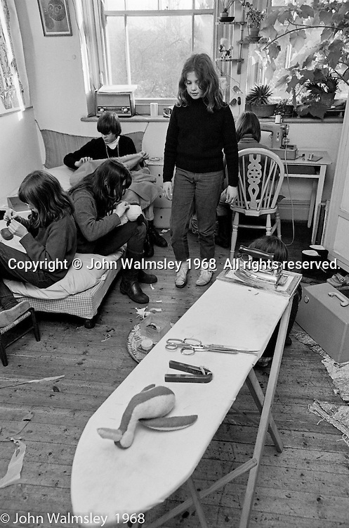 Sewing in the sewing teacher's own room, Summerhill school, Leiston, Suffolk, UK. 1968.
