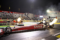 Feb 7, 2014; Pomona, CA, USA; NHRA top fuel dragster driver Steve Torrence (near lane) races alongside David Grubnic during qualifying for the Winternationals at Auto Club Raceway at Pomona. Mandatory Credit: Mark J. Rebilas-