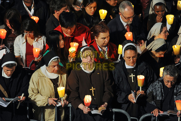 POPE BENEDICT XVI (Joseph Aloisius Ratzinger).presided the celebration of Good Friday Via Crucis at the Colosseum. Rome, Italy, April 22nd 2011..Easter catholic religious religion full nuns candles holding holy  pilgrims crowd .CAP/EPS/GG.©Giuseppe Giglia/EPS/Capital Pictures.