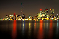 AJ0828, Canada, Ontario, Toronto, The illuminated downtown skyline of Toronto reflects in the waters of Lake Ontario at night (evening).