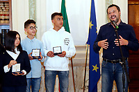 Matteo Salvini with Adam and Rami. Adam and Rami are sons of foreign citizens, but they will be given the Italian citizenship<br /> Rome March 27th 2019. The Minister of internal affairs Matteo Salvini meets the students that were on the school bus that was hijacked last week in Crema. Two of the students, Rami and Adam, hailed as heroes for helping saving their classmates when they had been abducted by a Senegalese with Italian citizenship bus driver who tried to set fire to the school bus.<br /> photo di Samantha Zucchi/Insidefoto