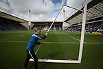 Preston North End 1 Reading 0, 19/08/2017. Deepdale, Championship. A member of the ground staff wheels away the practice goals from the pitch before Preston North End take on Reading in an EFL Championship match at Deepdale. The home team won the match 1-0, Jordan Hughill scoring the only goal after 22nd minutes, watched by a crowd of 11,174. Photo by Colin McPherson.