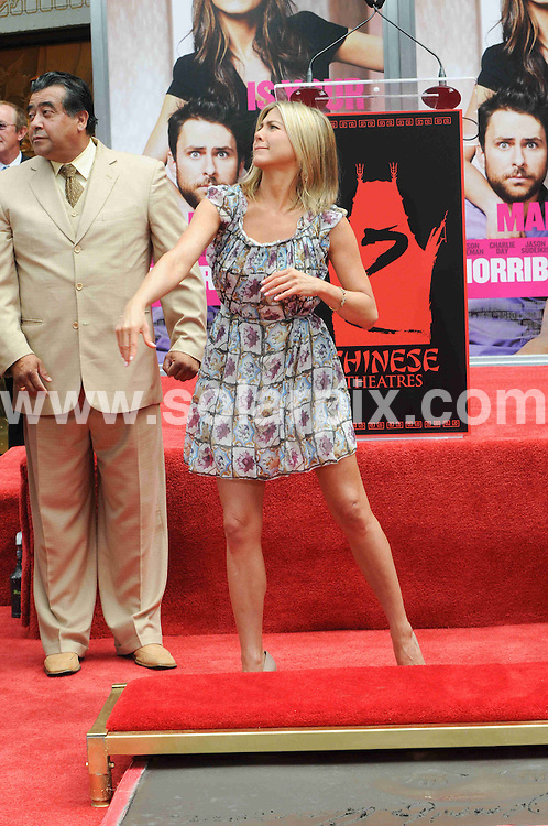 **ALL ROUND PICTURES FROM SOLARPIX.COM**                                             **SYNDICATION RIGHTS FOR UK, AUSTRALIA, DENMARK, PORTUGAL, S. AFRICA, SPAIN & DUBAI (U.A.E) & ASIA (EXCLUDING JAPAN) ONLY**                                                                                  Caption: Jennifer Aniston Hand and Footprint Ceremony at Grauman's Chinese Theatre in Hollywood, Los Angeles, USA.                                                                              This pic: Jennifer Aniston                                                                                             JOB REF: 13681 PHZ Evans      DATE: 07_07_2011                                                           **MUST CREDIT SOLARPIX.COM OR DOUBLE FEE WILL BE CHARGED**                                                                      **MUST AGREE FEE BEFORE ONLINE USAGE**                               **CALL US ON: +34 952 811 768 or LOW RATE FROM UK 0844 617 7637**