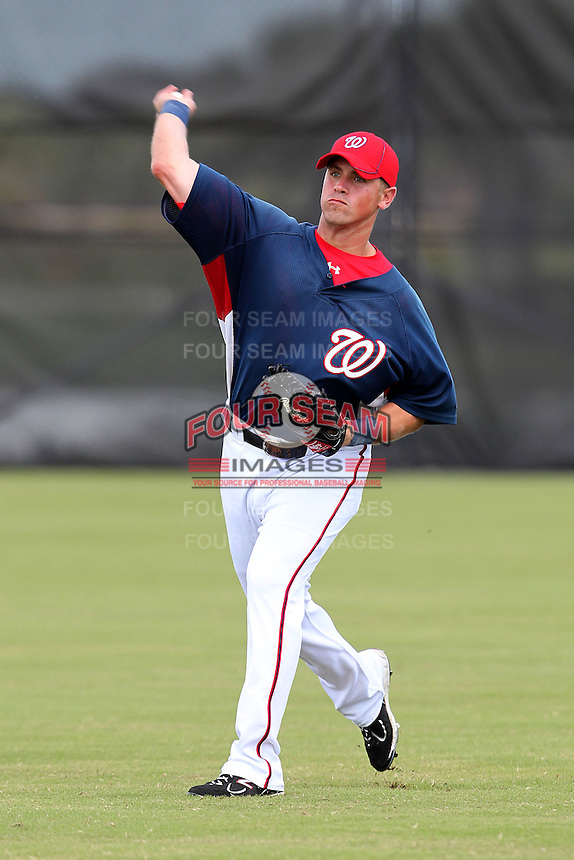 Washington Nationals outfielder Tyler Moore #14 warmus up before an Instructional League game against the national team from Italy at Carl Barger Training Complex on September 28, 2011 in Viera, Florida.  (Mike Janes/Four Seam Images)